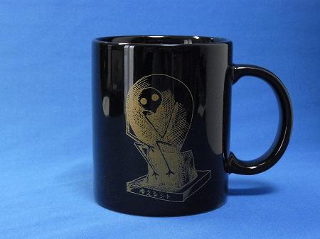 ゆるしと・考えるシトのマグカップ黒